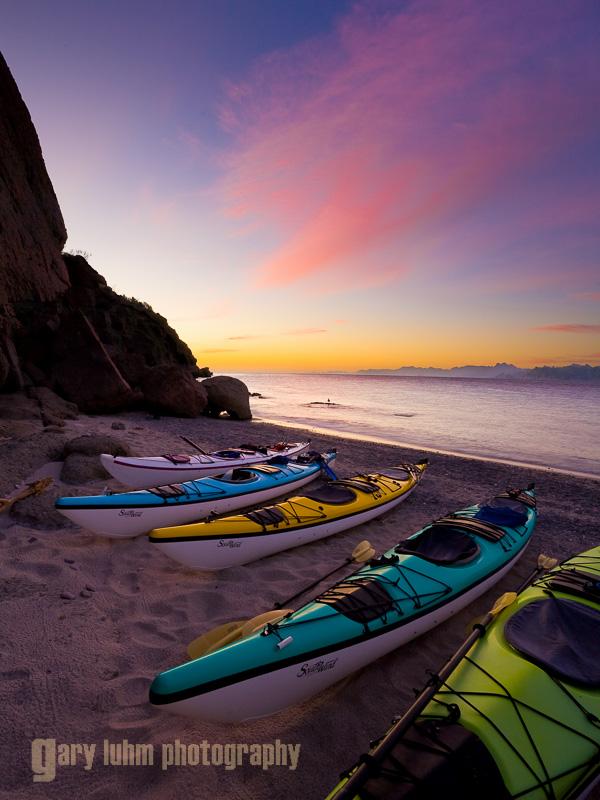 Sunrise with sea kayaks on beach on Isla Carmen, Baja, Mexico.