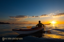 Sea kayaker paddling at sunrise, Sea of Cortez, Baja, Mexico.