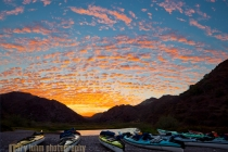Sea kayaks on the shore at Puerto Balandra on Isla Carmen at a classic Baja sunrise.
