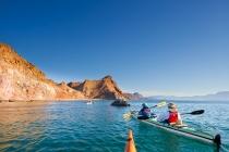 Sea kayaking along the shore of Isla Carmen, Sea of Cortez, Baja, Mexico.
