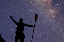 Sea kayaker celebrates the Milky Way, Isla Carmen, Baja, Mexico.