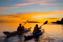 Sea kayakers paddle toward sunrise, Los Gatos, Sea of Cortez, Baja, Mexico.