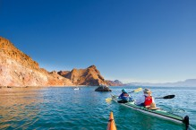 Sea kayaking along the shore of Isla Carmen, Sea of Cortez, Baja, Mexico.