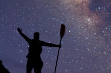 Sea kayaker celebrates the Milky Way, Isla Carmen, Baja, Mexico.