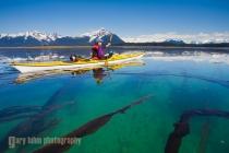 Woman sea kayaker in Beardsley Island group, Glacier Bay National Park, Alaska. (MR).