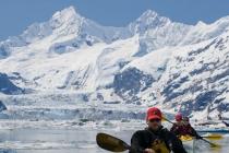Sea kayakers in front of John Hopkins tidewater glacier, in John Hopkins Inlet, Glacier Bay, Alaska.