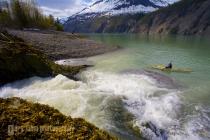 Woman sea Kayaker in Tidal Inlet, Glacier Bay National Park, Alaska, USA.