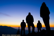 Young adult group enjoying sunset on Blue Mt. at Deer Park, Olympic National Park, WA.