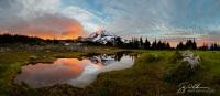 Tarn reflections and Mt. Rainier, a sunrise at Spray Park, Mt. Rainier National Park. Assembled from five tripod shot verticals.
