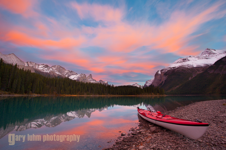 A sea kayak aside Maligne Lake, Jasper National Park, Albert, at sunset