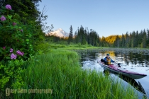 A woman in a sea kayak paddles on Trillium Lake, Oregon.