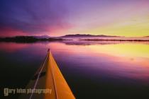 Kayak bow and sunrise on Skagit Bay, Washinton, USA.