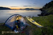 Man at kayak camp, Strawberry Island, San Juan Islands, Washington State, (MR).