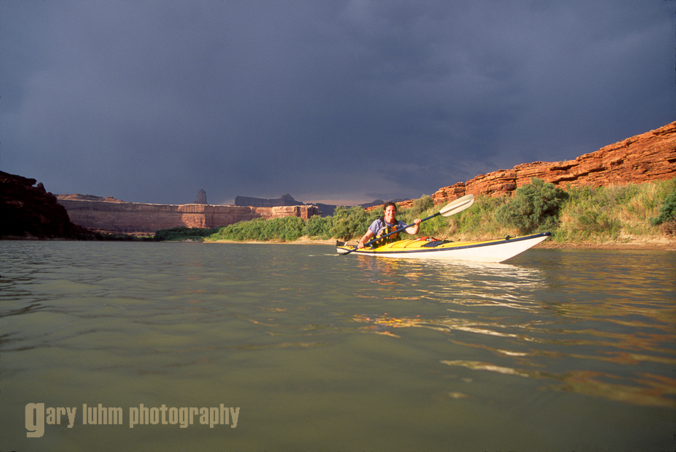 Woman sea kayaker on the Green River, Canyonlands National Park, Utah.