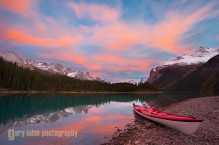 A sea kayak aside Maligne Lake, Jasper National Park, Albert, at sunset