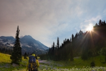 Backpacker at Indian Henry\'s Hunting Ground, Mt. Rainier NP,