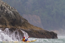 Sea kayaker Eugene Lavaque near Alexander Island, Olympic National Park, Washington State.