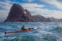 Sea kayaker Vlady de la Toba of Sea Kayak Adventures in reflected waves off Punta Lobos, Isla Carmen, Baja, MX.