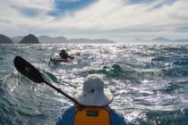 Sea kayakers experience some rough water rounding Punta Lobos, Isla Carmen, Baja, MX. (MR)