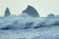 Ken DeBondt, on a big wave day, kayak surfing at the La Push Pummel, La Push, Washington, USA.