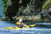 Sea kayaker Tim Walsh at entrance to Johnson Lagoon, Checleset Bay, Vancouver Island, British Columbia, Canada.