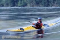 Sea kayaker Bryan Smith surfing wave at Skookumchuck Rapids, British Columbia, Canada.