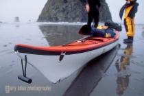 Kayak damage, on Olympic coast. Olympic National Park, Wahsington State.