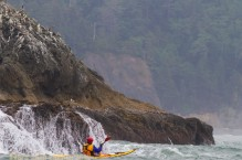 Sea kayaker Eugene Lavaque near Alexander Island, Olympic National Park, Washington State.