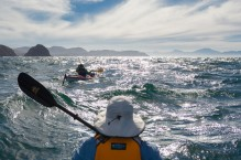 Sea kayakers experience some rough water rounding Punta Lobos, Isla Carmen, Baja, MX. (MR)