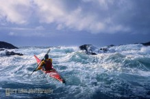 Sea kayaker Tim Walsh in confused seas and 17 ft swell off Chichigof Island, Southeast Alaska.