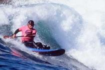 Mike Johnson. Surf kayak designer Mike Johnson on a wave ski.