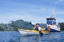 Kayak mothership Home ShoreLeaving the mothership Home Shore by sea kayak in Redfish Bay, Baranof Island, AK.