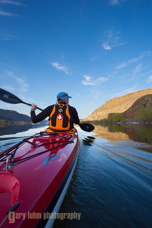 Male sea kayaker on Alkali Lake in eastern Washington state. (MR)