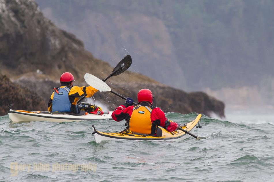Sea kayakers near Alexander Island, Olympic National Park, Washington State.