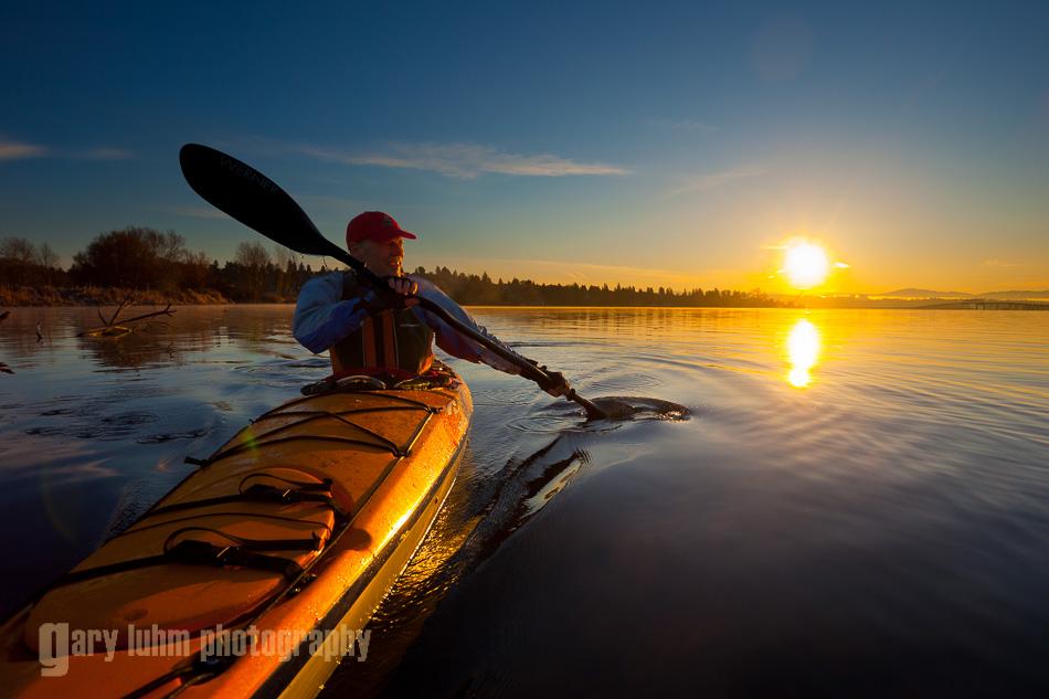 Sea kayaker at dawn on Lake Washington, Seattle, Washington State.