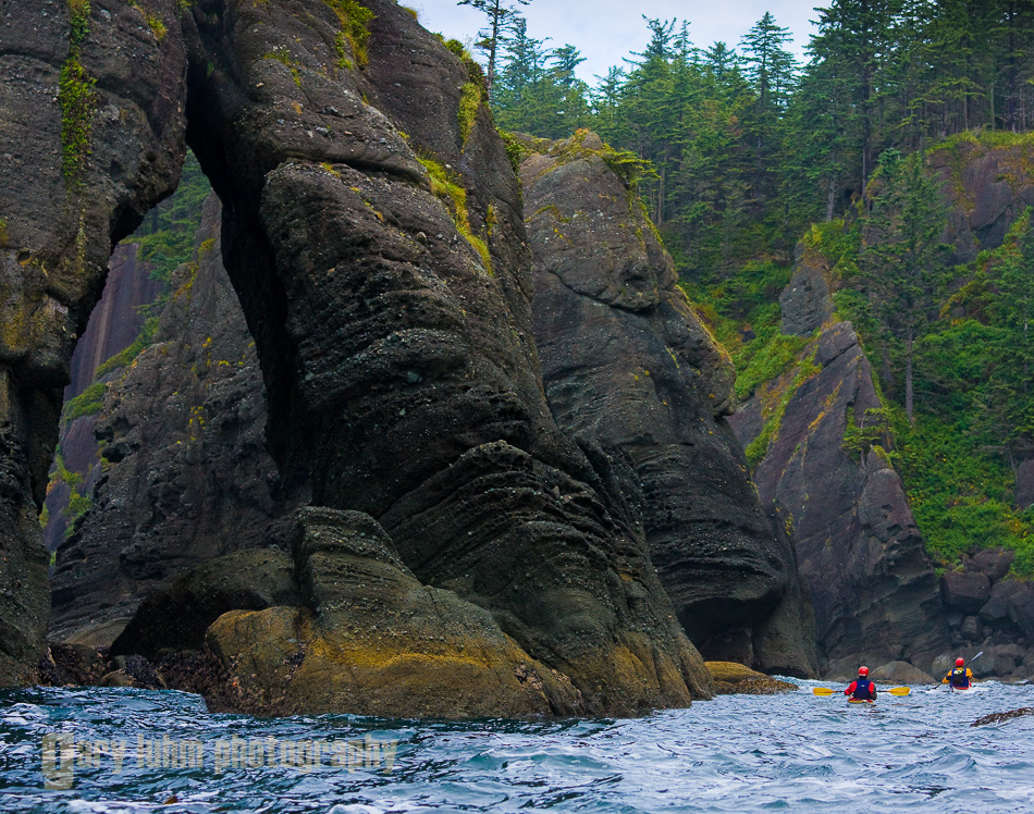 Sea kayakers explore sea stacks and arches at Cape Flattery, Olympic Penninsula, Washington State.