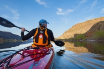 Male sea kayaker on Alkali Lake in eastern Washington state. (MR)