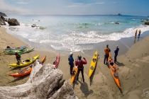 Sea kayakers on a desolate Olympic Coast beach near Cape Flattery. Digital composite.