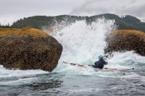Sea kayaker Don Cheyette plays in rock garden in moderate swell, near Cape Flattery on the Olympic Coast.