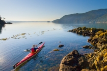 Sea kayaker on calm sea, Cypress Island, San Jaun Islands, Washington State. (MR).