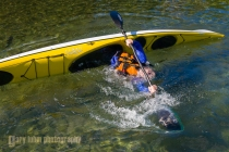 Eskimo roll practice in a sea kayak, at Waldo Lake, Oregon. (MR).
