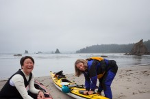 Women packing their sea kayaks at Toleak Point, Olympic National Park, Washington State. (MR)