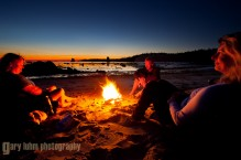 Kayakers at campfire at Toleak Point, Olympic Coast, Olympic National Park, Washington State.