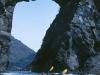 Astrolabe Arch. Sea kayakers pass through Astrolabe Arch, Glacier Bay National Park, Gulf of Alaska, AK.