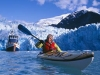Paddling near the shear blue walls of the tidewater South Sawyer Glacier. Tracy Arm is like a Yosemite Valley on water - granite faces, plunging waterfalls, and no place to camp.