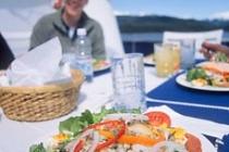 Fresh Crab Salad. Outdoor lunch aboard the Ursa under sunny skies, Baranof Island, Alaska.