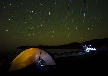 Star-trail at Isla Carmen, Baja, MX. I fired the flash seven times inside the tent, with a warming gel