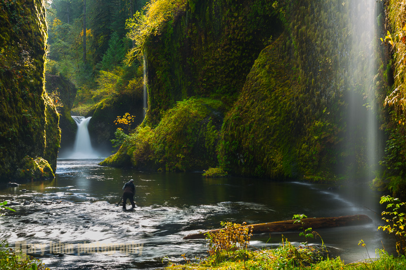 After crossing Eagle Creek, I backed up to include the water streaming in from the canyon walls. Backlighting and a polarizing filter enhance the scene, and a hat held out and above the lens prevented flare. The photographer in the image has donned hip waders, allowing him movement to just about anywhere in the basin. Punchbowl falls, Eagle Creek, Columbia River Gorge, Oregon. Canon 5D III, 24-105mm f/4L @55mm, f/16,   .4sec, iso50.