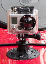 GoPro Hero2 w/tripod mount and suction cup on a kayak deck.
