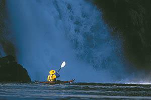 Sea kayaker in Red Bluff Bay, Chichagof Island, Alaska.